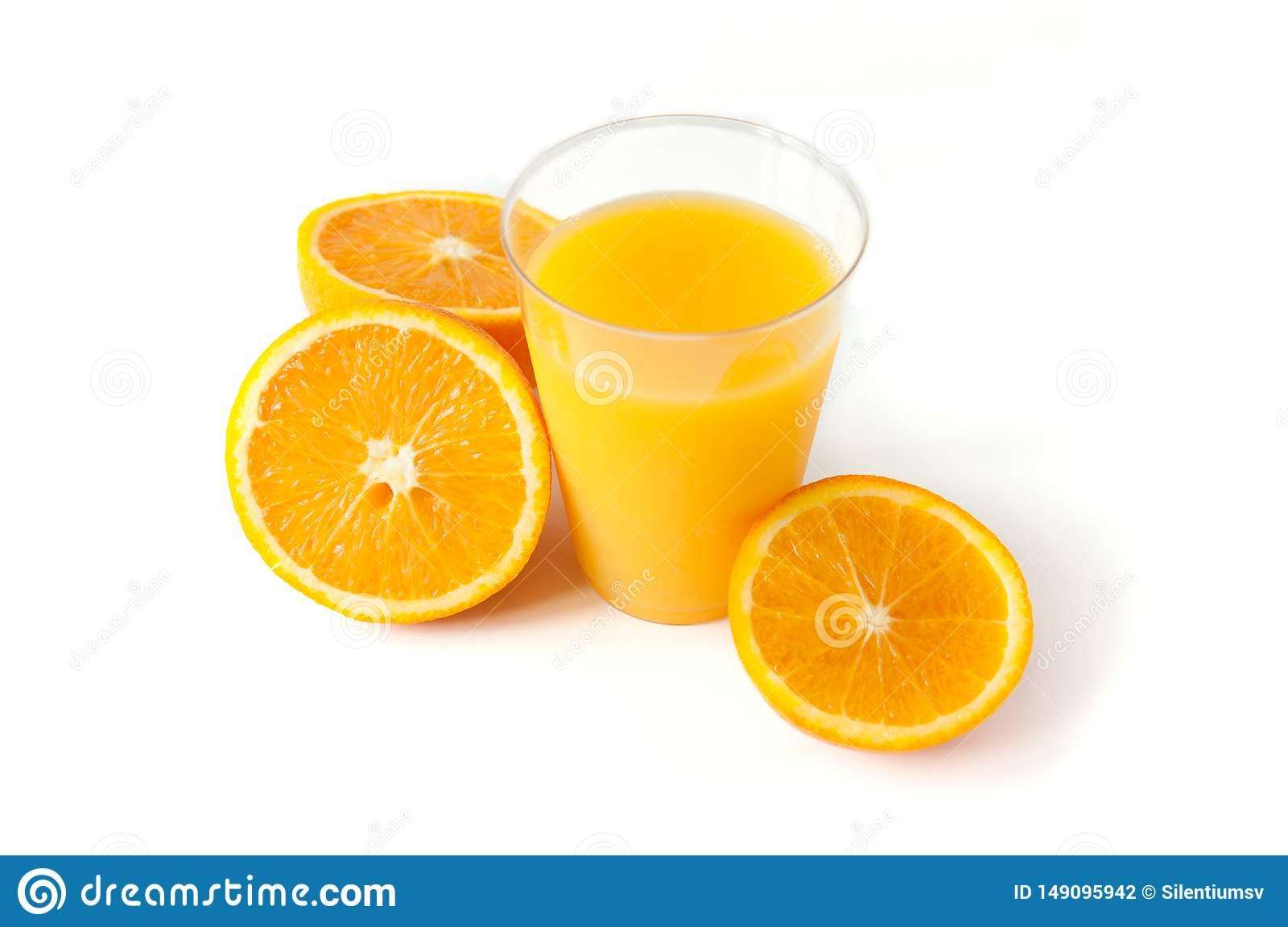 Fresh orange juice in a glass. Round orange slices on a white background. Citrus tropical fruit background. Bright food.