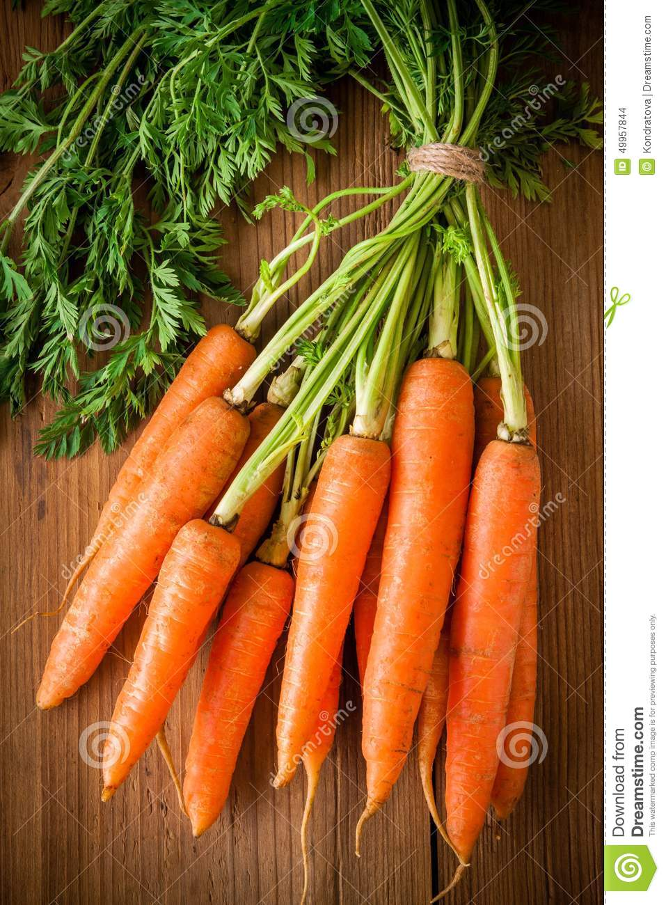 Fresh organic carrots bunch on wooden background