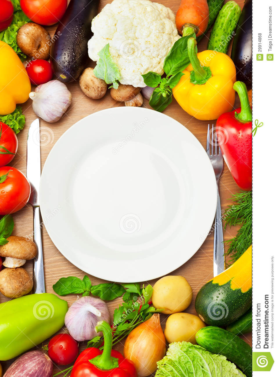 Organic Vegetables Around White Plate With Knife And Fork ...