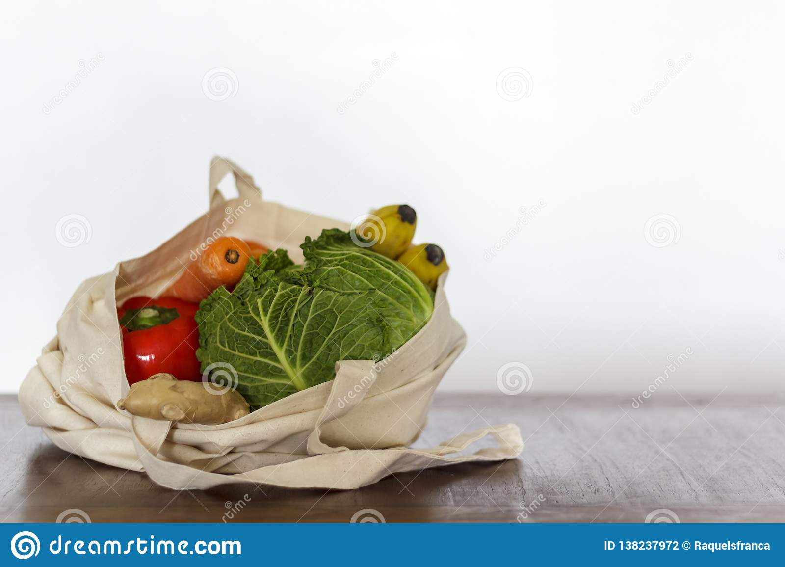 Fresh organic vegetables and fruit in cotton bag. Zero Waste, Plastic free concept