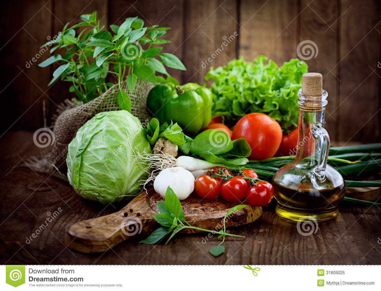 Fresh ingredients for cooking in rustic setting: tomatoes, basil ...