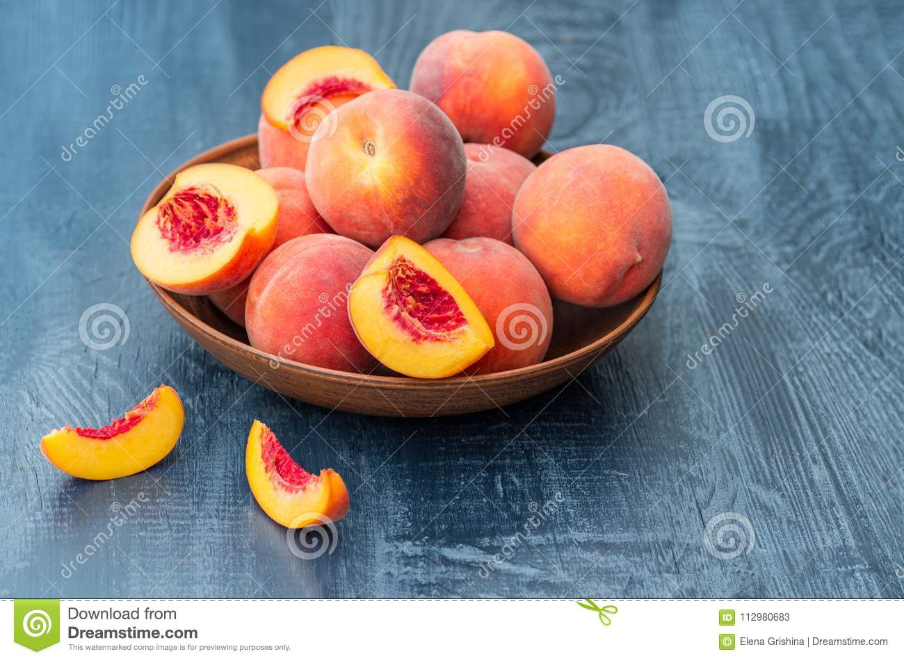 Fresh peaches on a wooden background. Close-up