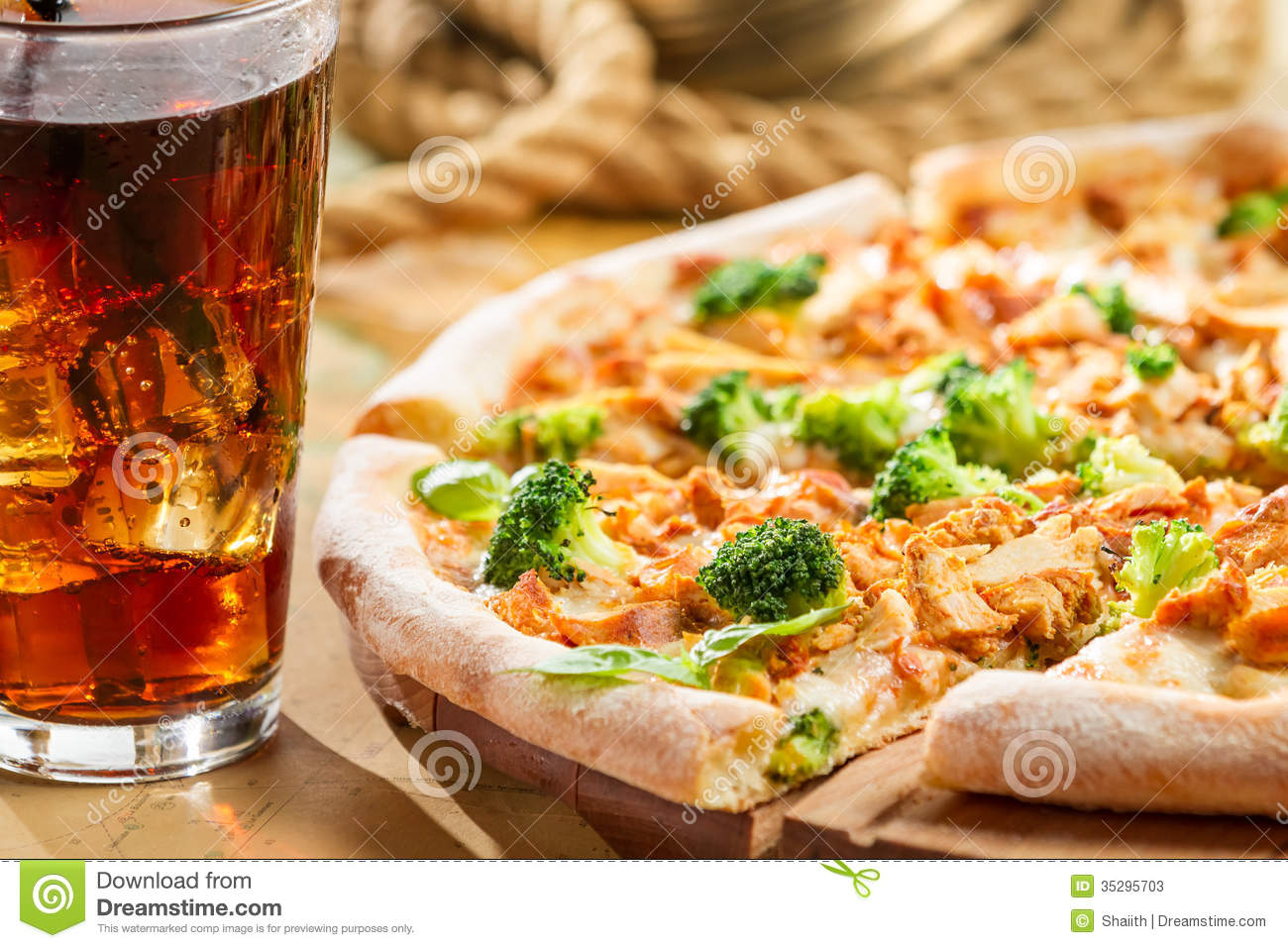Fresh Pizza With Broccoli And Chicken Served With Cold
