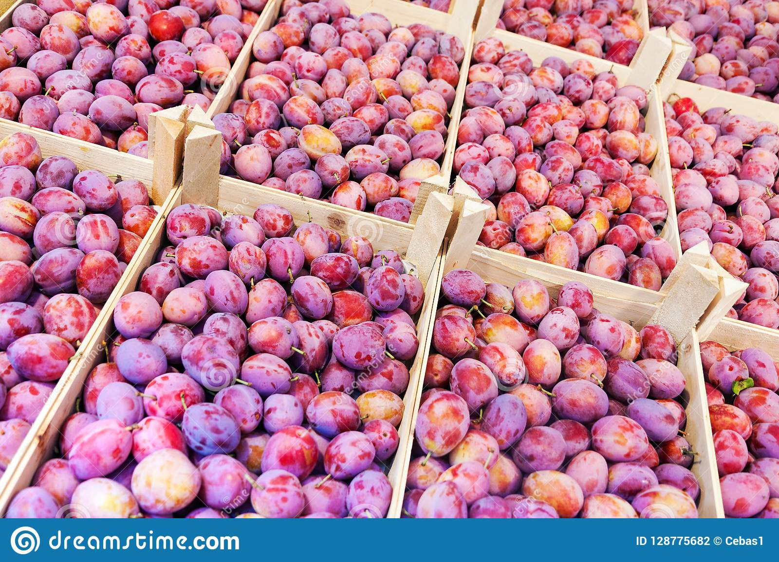 Fresh Plum Fruits In Wooden Boxes For Sale At Market Stock Photo