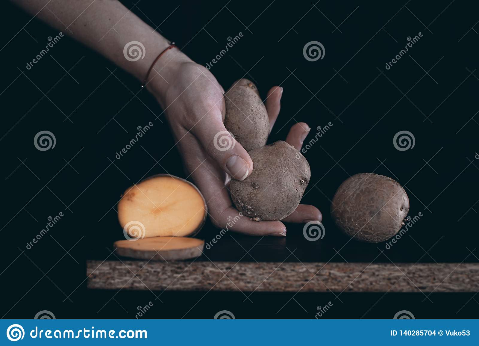 Fresh potatoes in hand