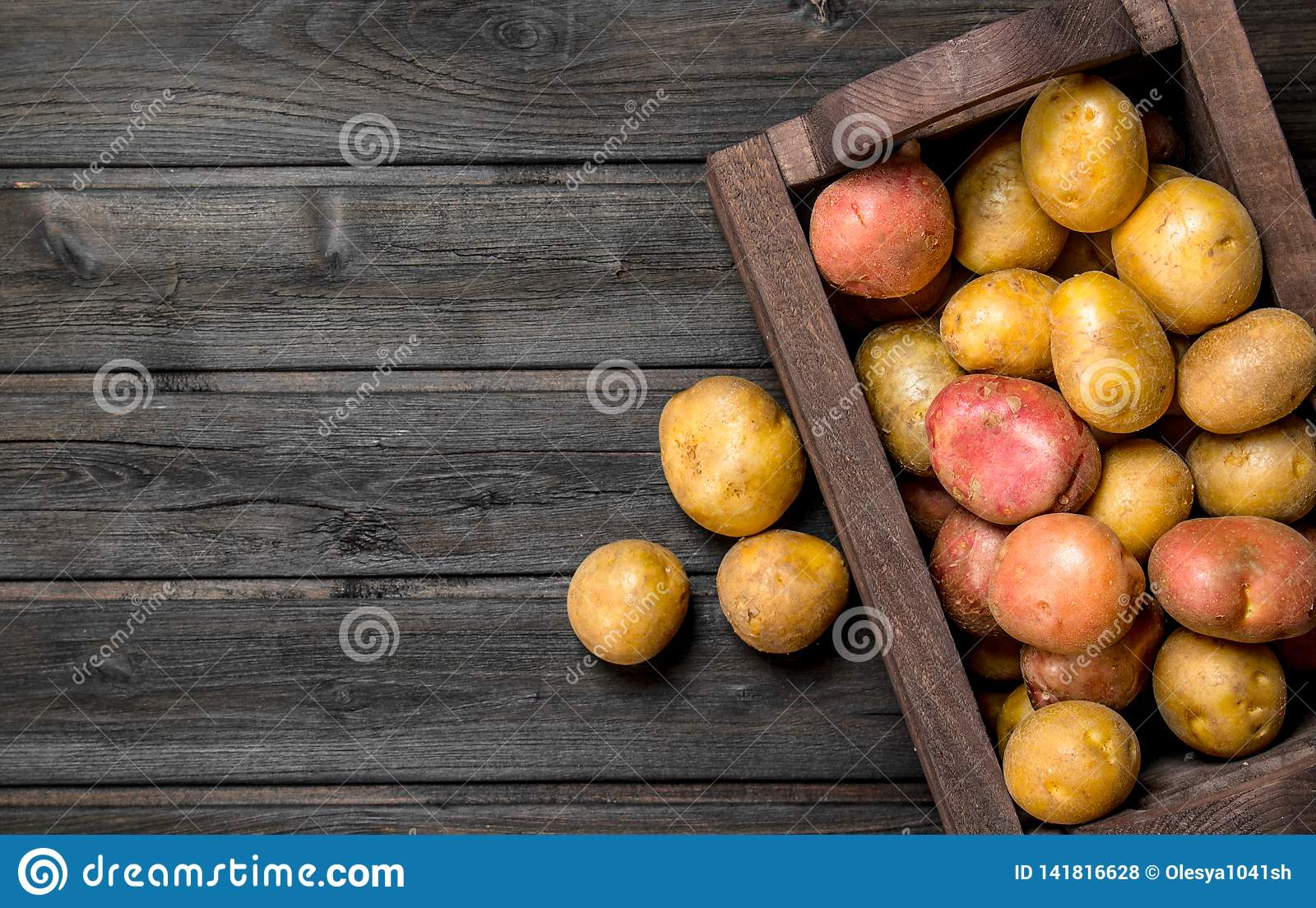 Fresh potatoes in a wooden box