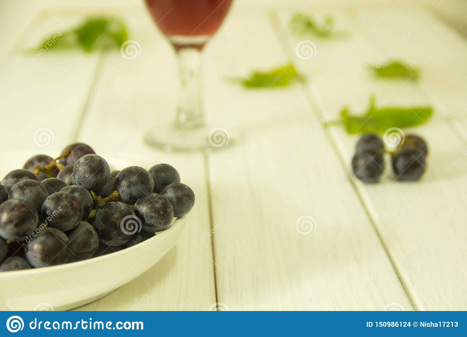 Fresh purple grapes on the plate