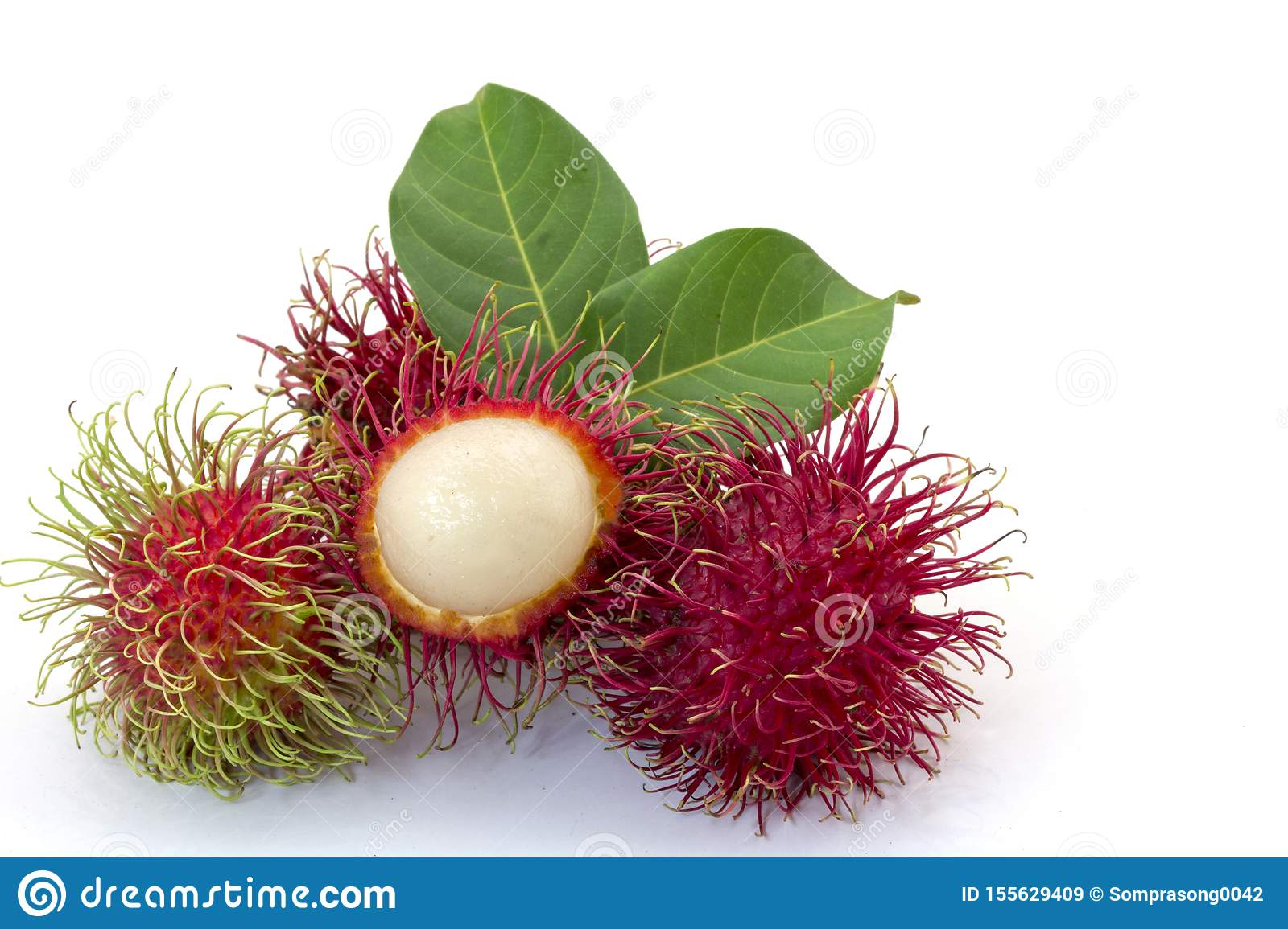 Fresh Rambutan with green leaves isolated on white background