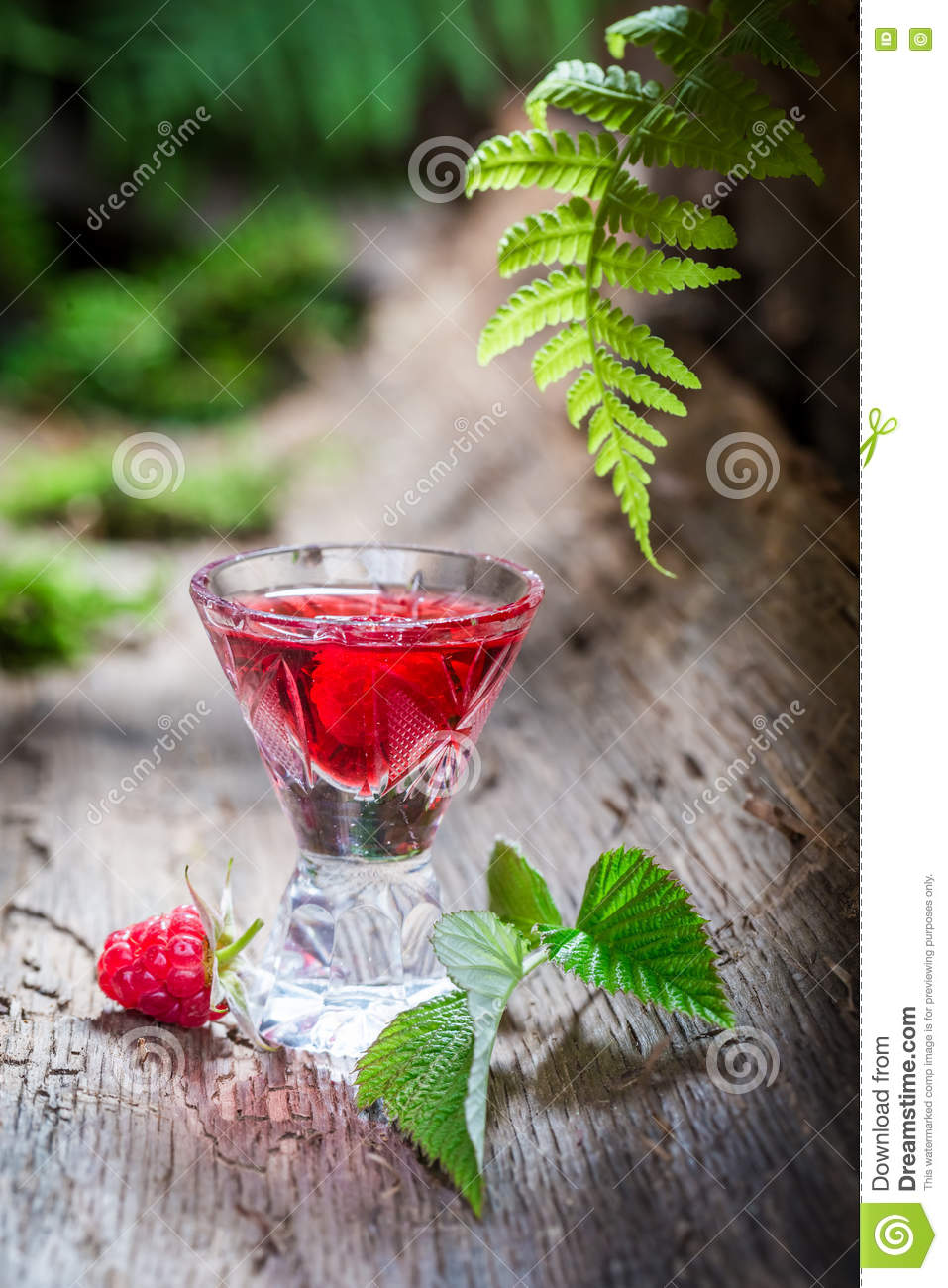 Fresh raspberries liqueur made of fruits and alcohol