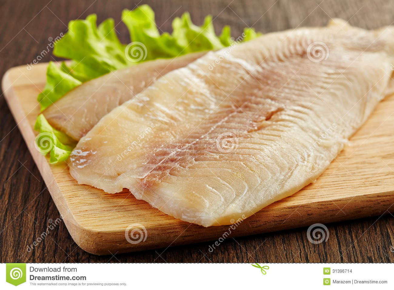 Fresh raw fish fillet stock images image 31396714 for Fish fillet board