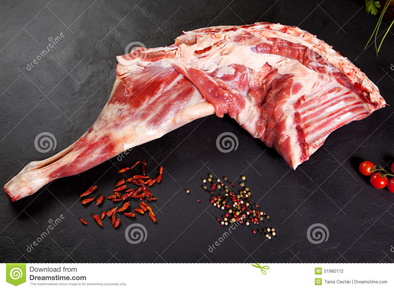 Fresh And Raw Meat. Raw Lamb Leg With Tomato And Pepper Stock ... for Lamb Meat Photography  45ifm