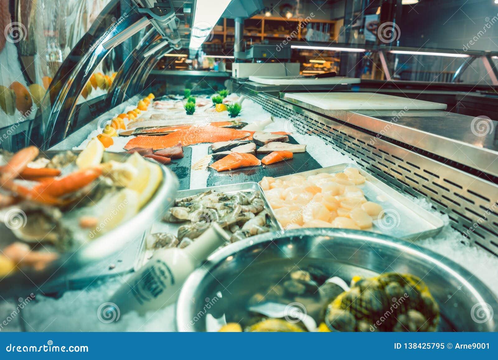 Fresh raw salmon fillet in the freezer of a modern restaurant