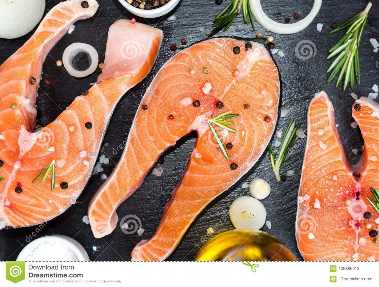 Fresh Raw Unprepared Fish Salmon Or Trout Steaks In A Skillet For