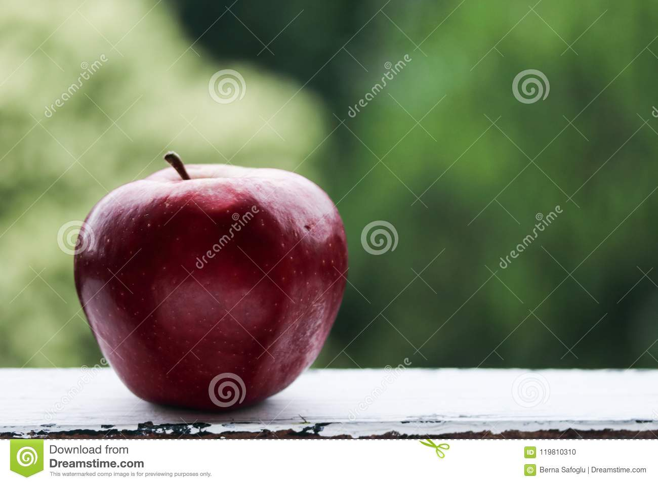 Red apple on a green background