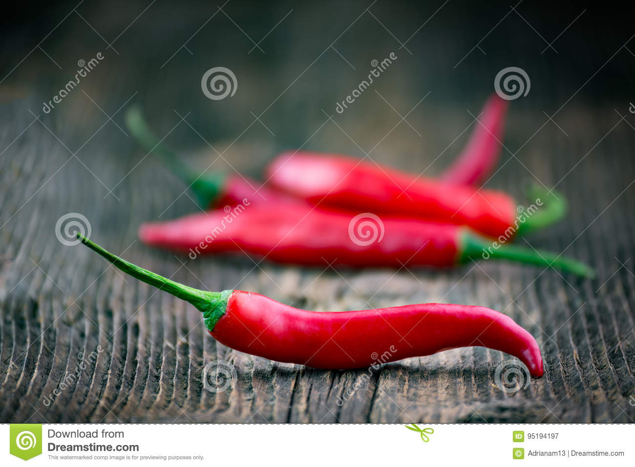 Fresh red chilli pepper on a wooden table
