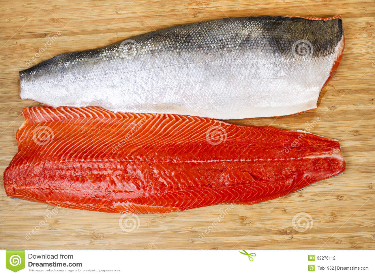 Fresh red salmon fillets on bambbo board stock photography for Fish fillet board