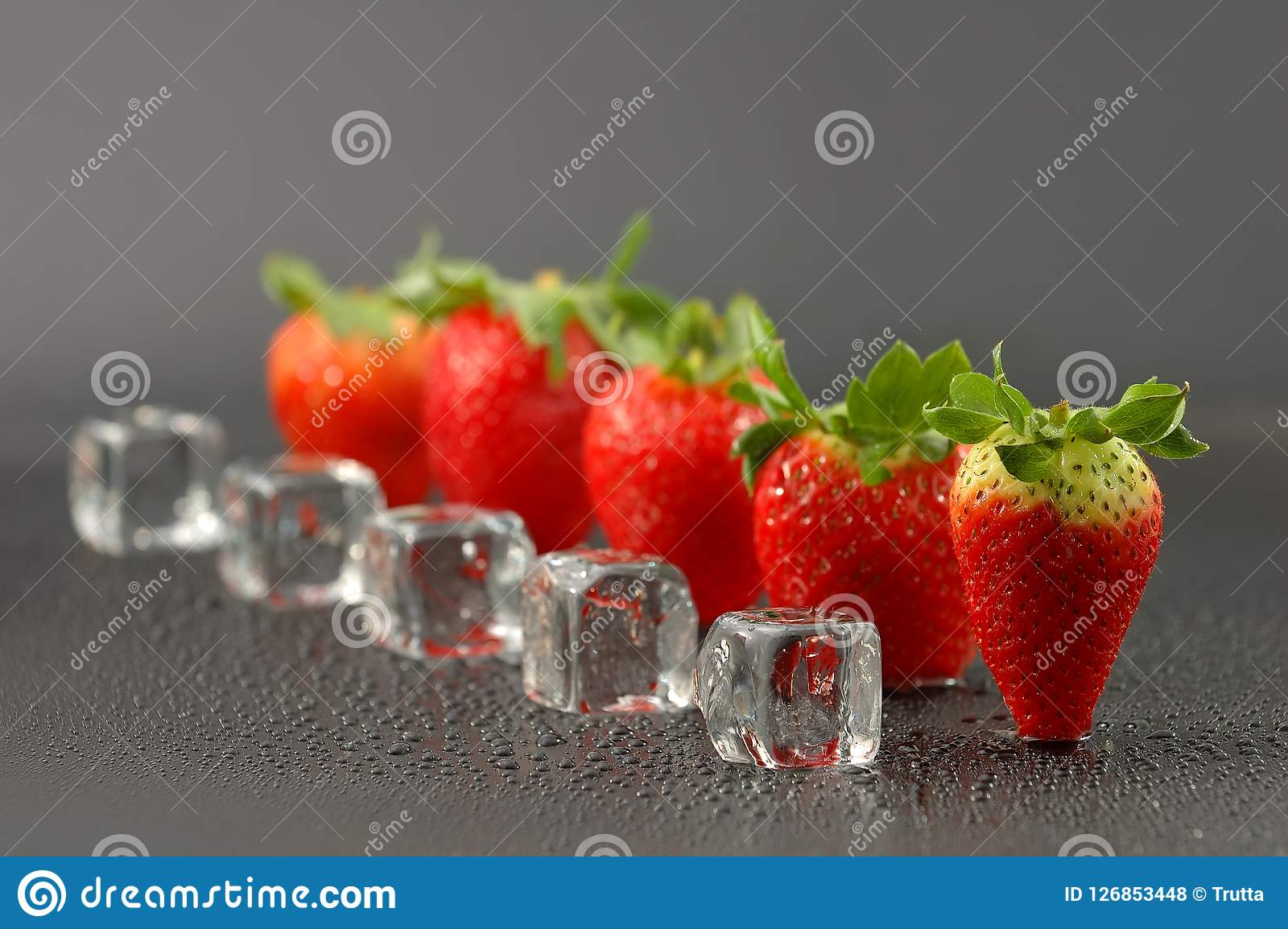Fresh red strawberries with ice cubes