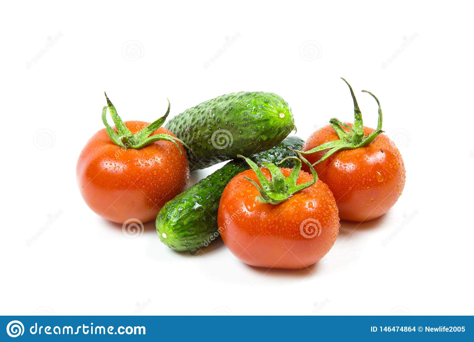 Fresh red tomatoes and cucumbers