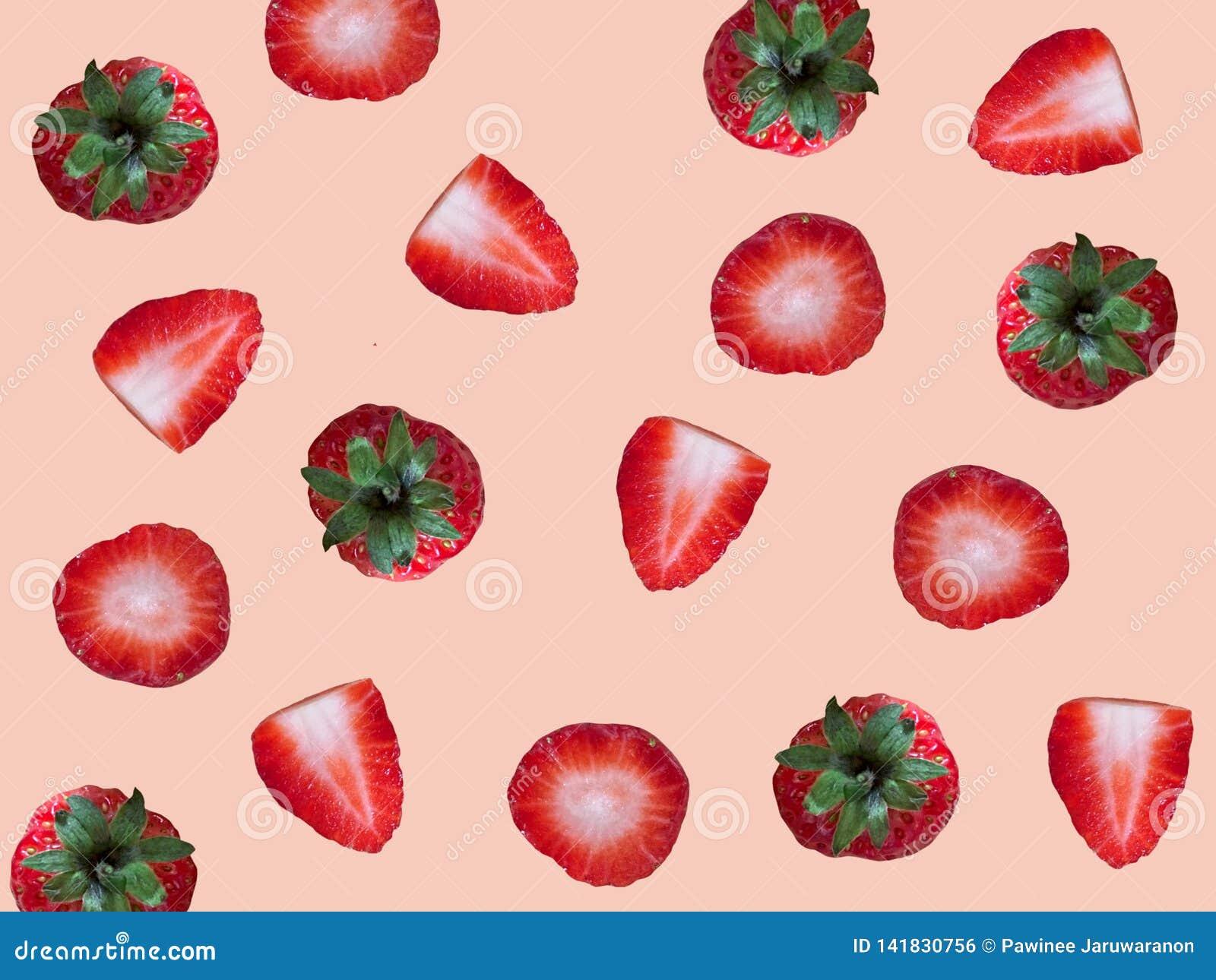 Fresh ripe strawberry pattern isolated on light pink background.