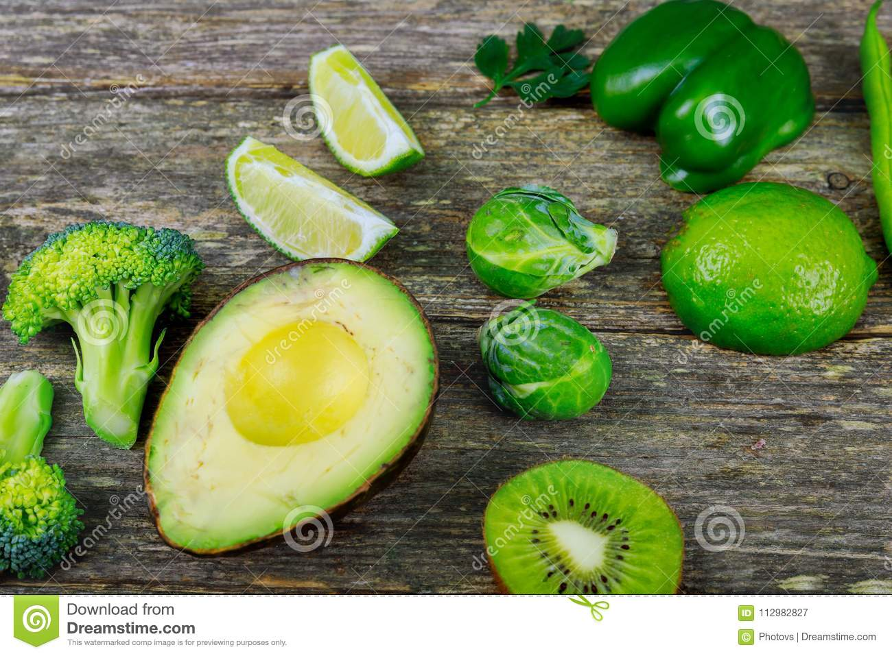 Fresh ripe vegetables on wooden table background