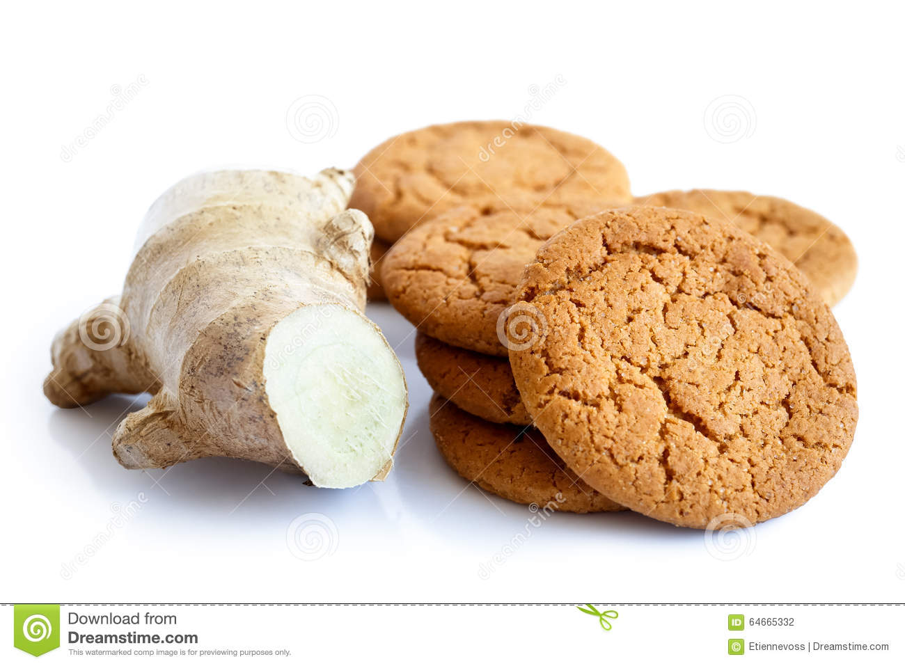 Fresh root ginger with ginger biscuits.