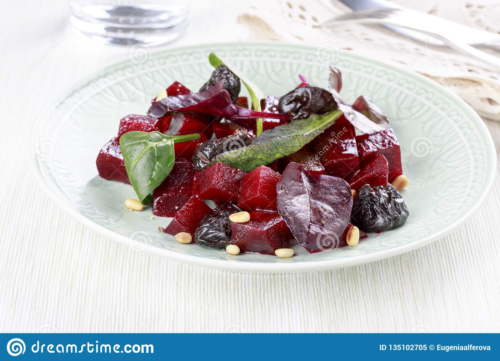 Fresh salad with beet, prunes and pine nuts