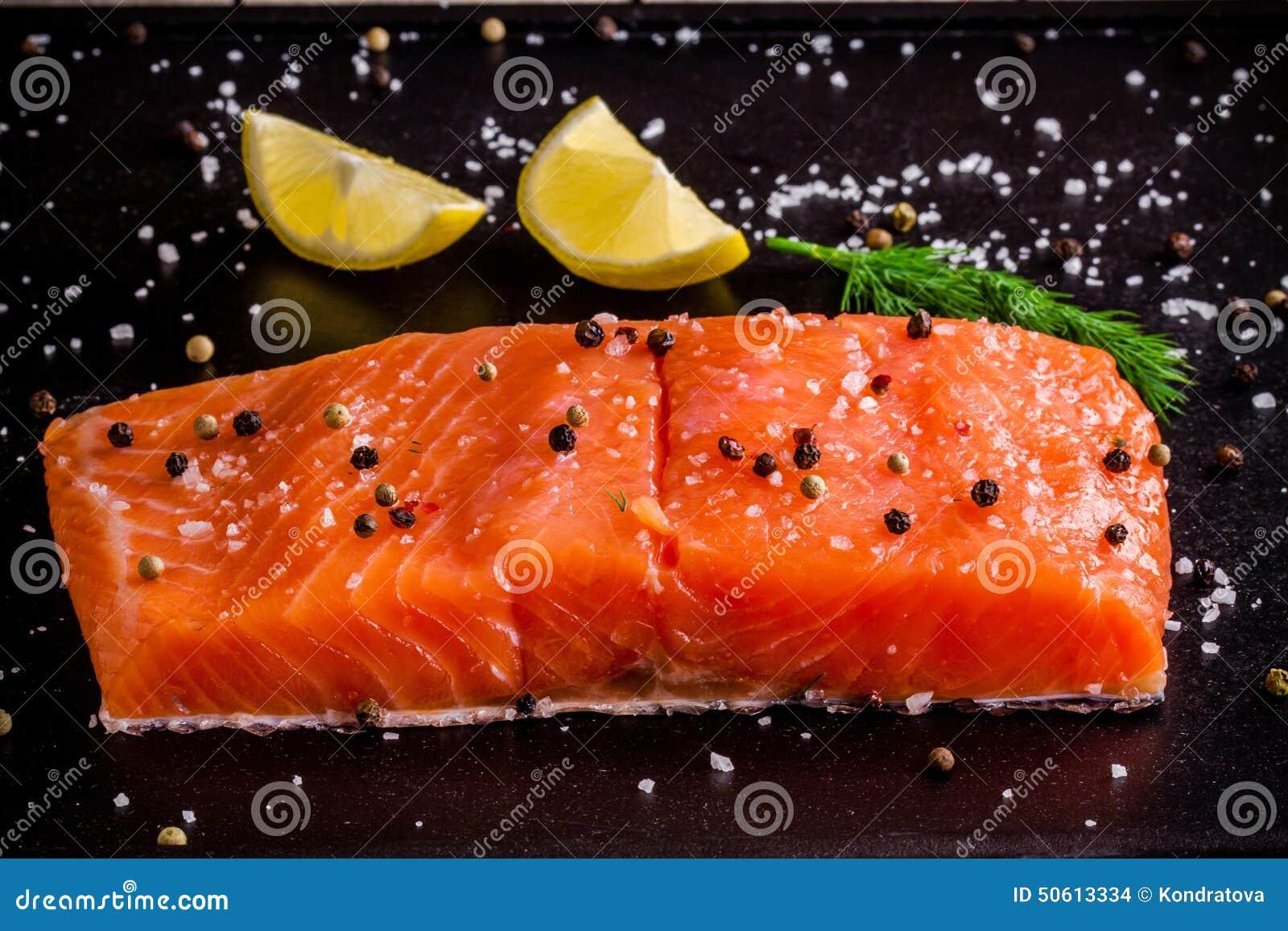 Fresh Salmon Fillet With Lemon, Peppr And Sea Salt Stock Photo ...
