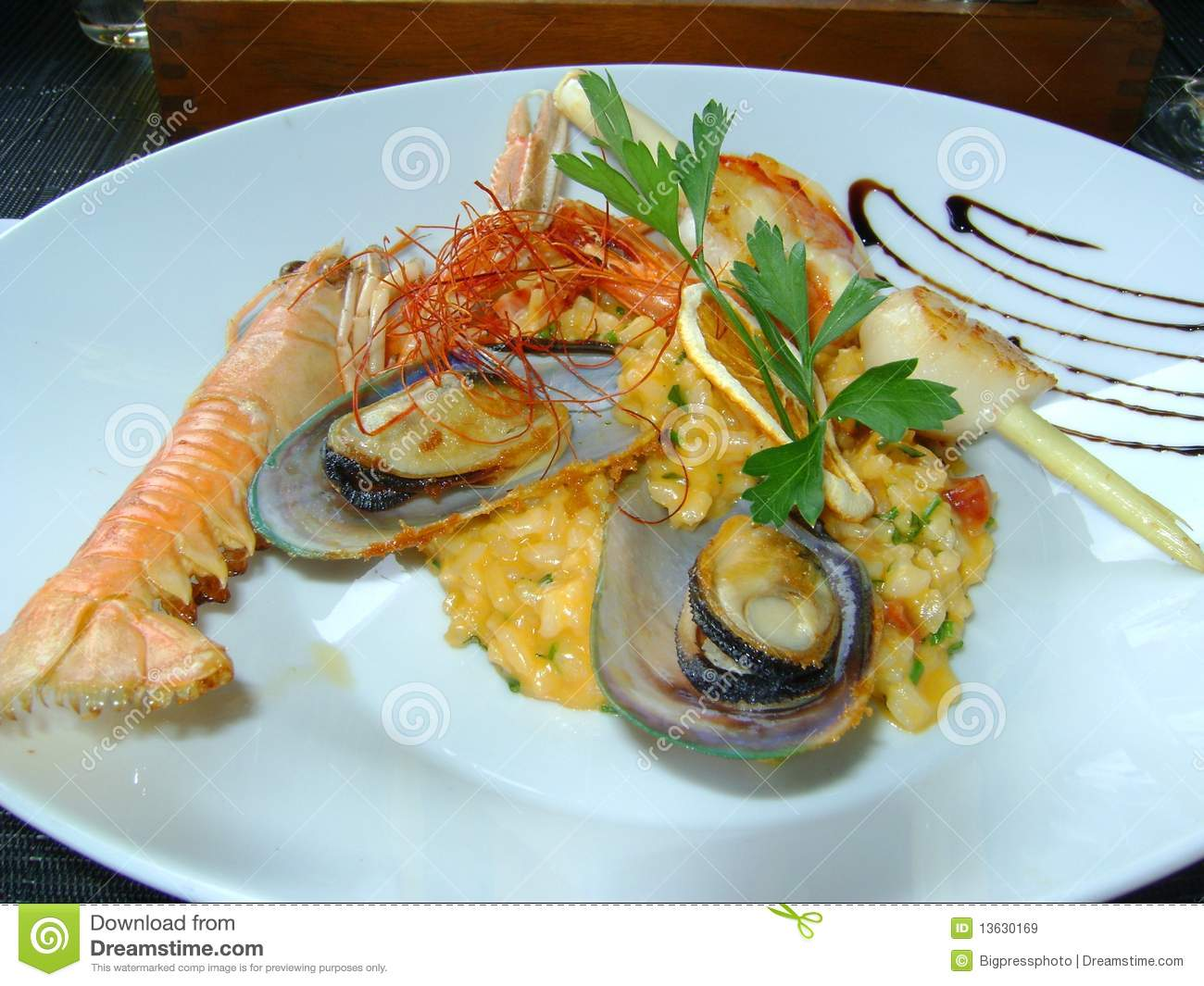 ... in the shell octopus and langostine served with saffron rice in