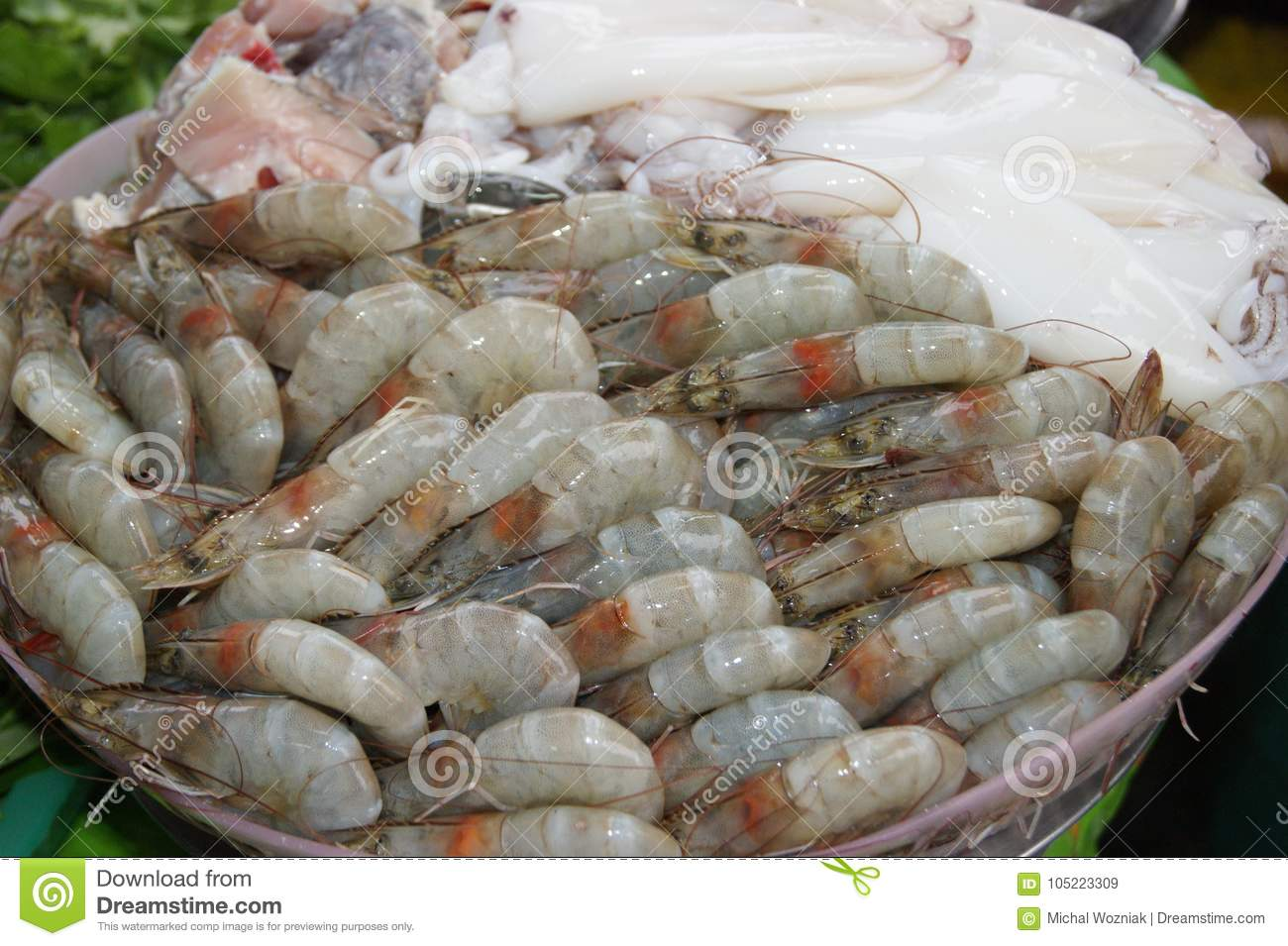 Fresh shrimp and squid on Ice in the market Thailand