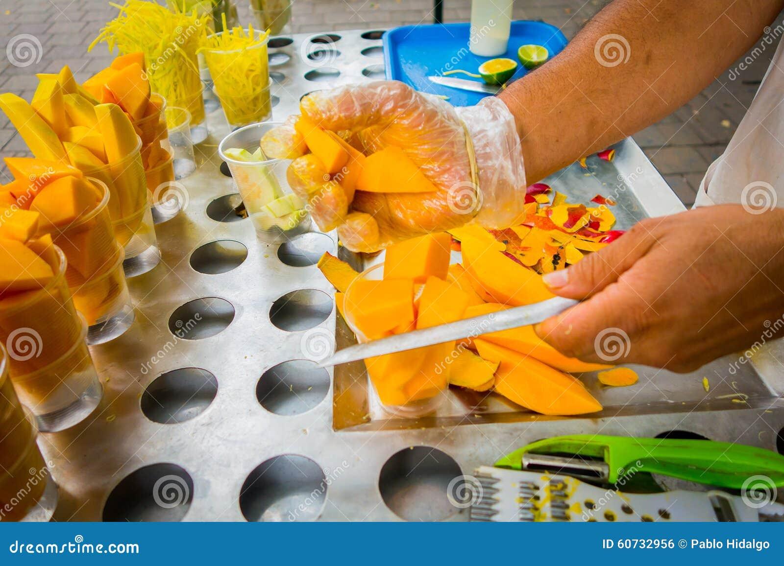 Fresh sliced mango, street food in Medellin