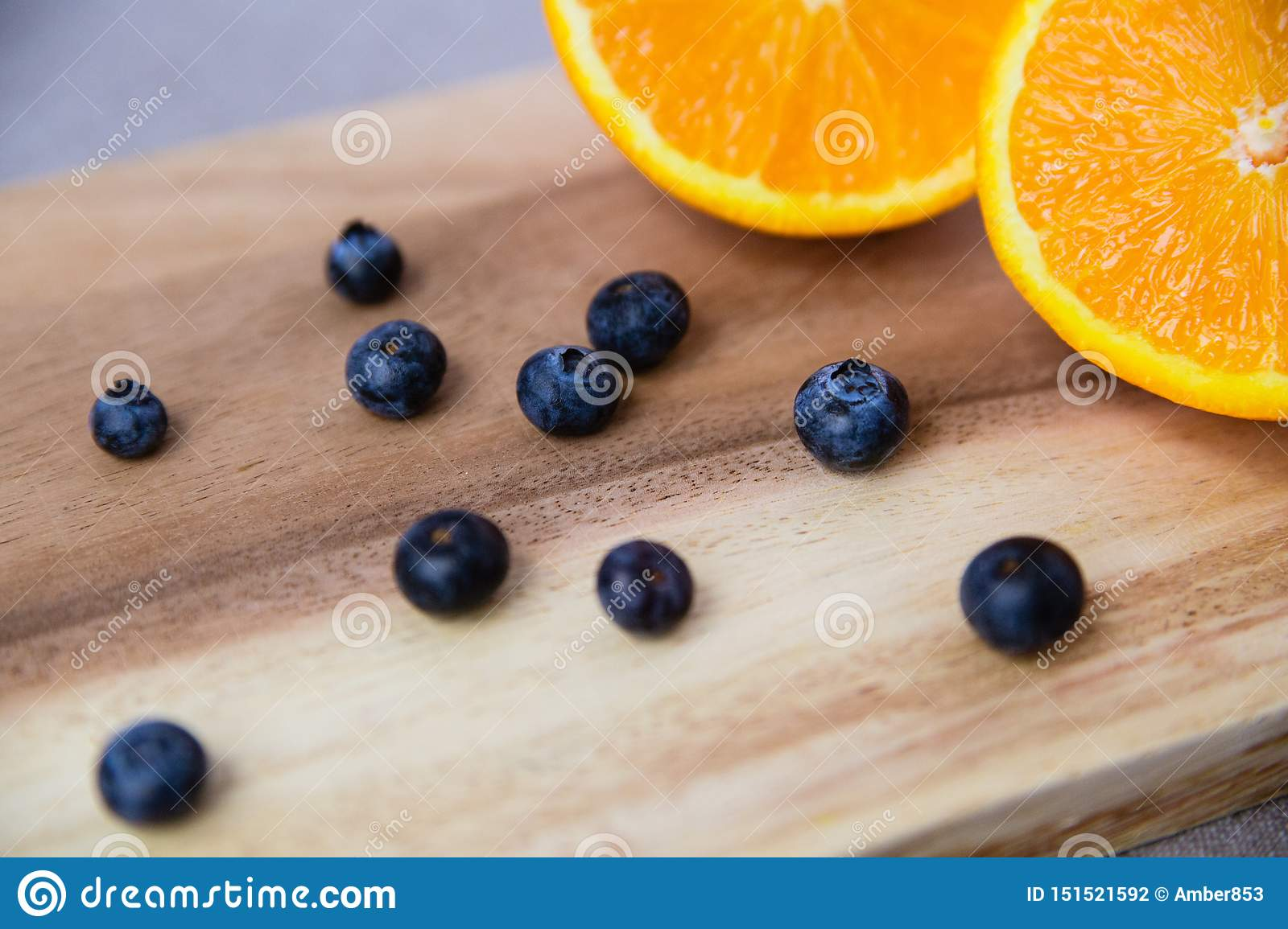 Orange and blueberries on Wooden Cutting Board
