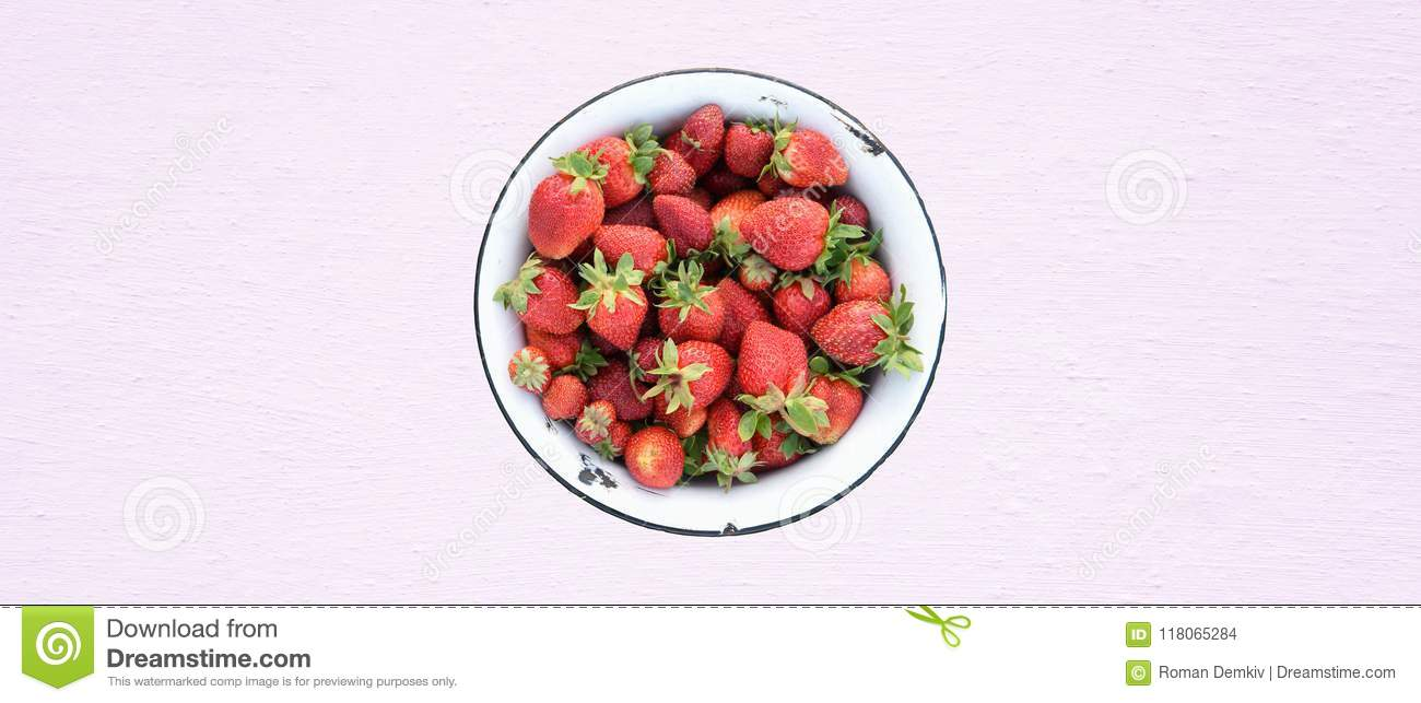 Fresh strawberries in retro bowl, organic food, textured background with Pink Lavender color toning, top view