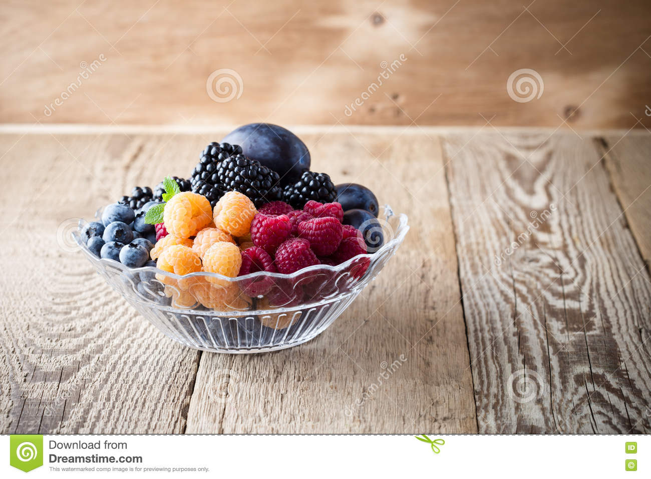 Download Fresh Summer Berries And Fruits In Glass Bowl On Wooden Rustic Stock Photo - Image of background, harvested: 76595548
