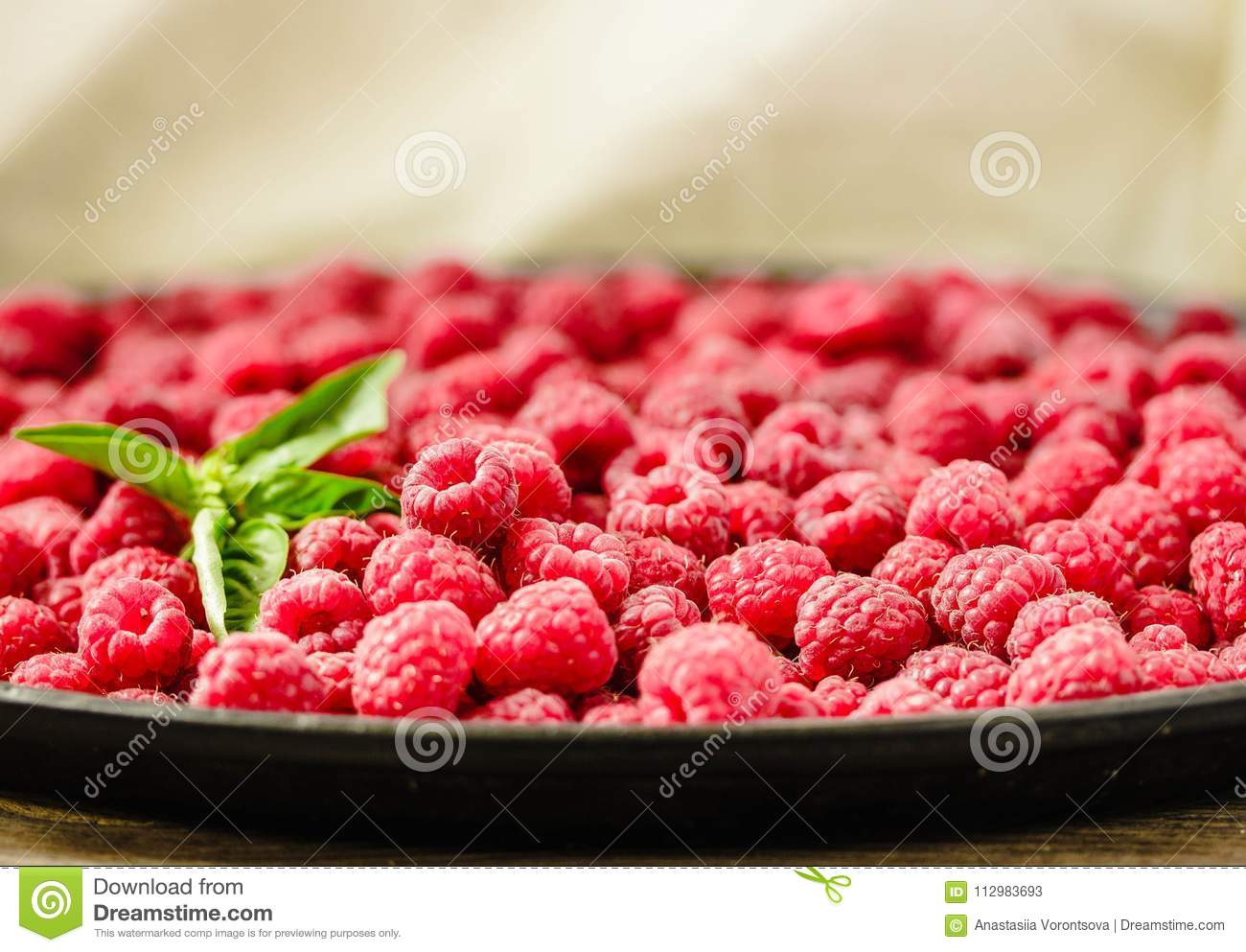 Fresh sweet raspberry and green basil.Selective focus. Horizontally..Detox diet food and raw vegan concept.