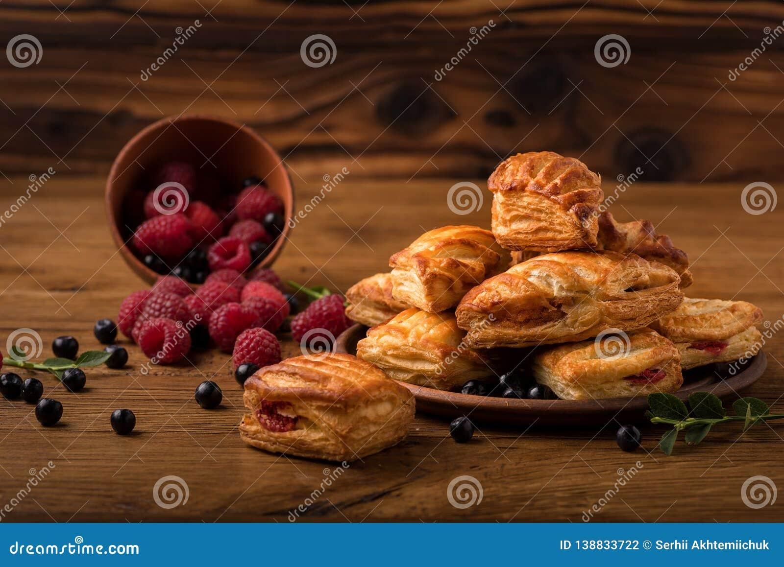 Fresh tasty pastries with raspberry jam