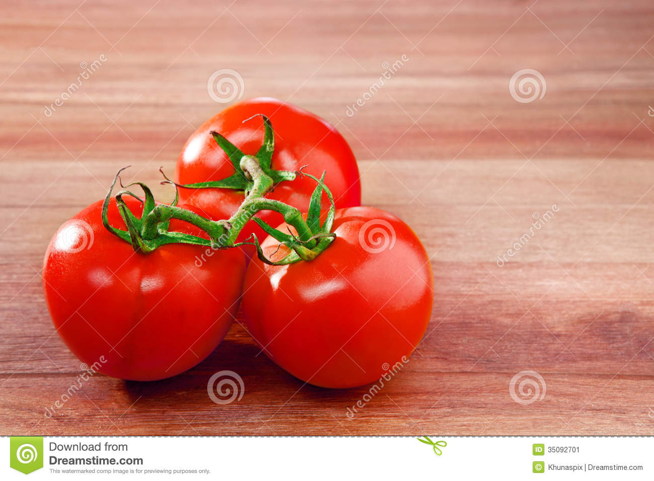 Fresh three of tomato on top wood table with copy space