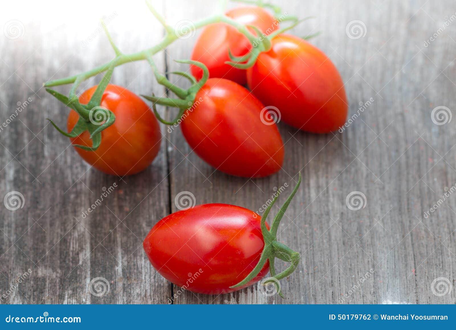 Fresh tomato on wood background stock photo image