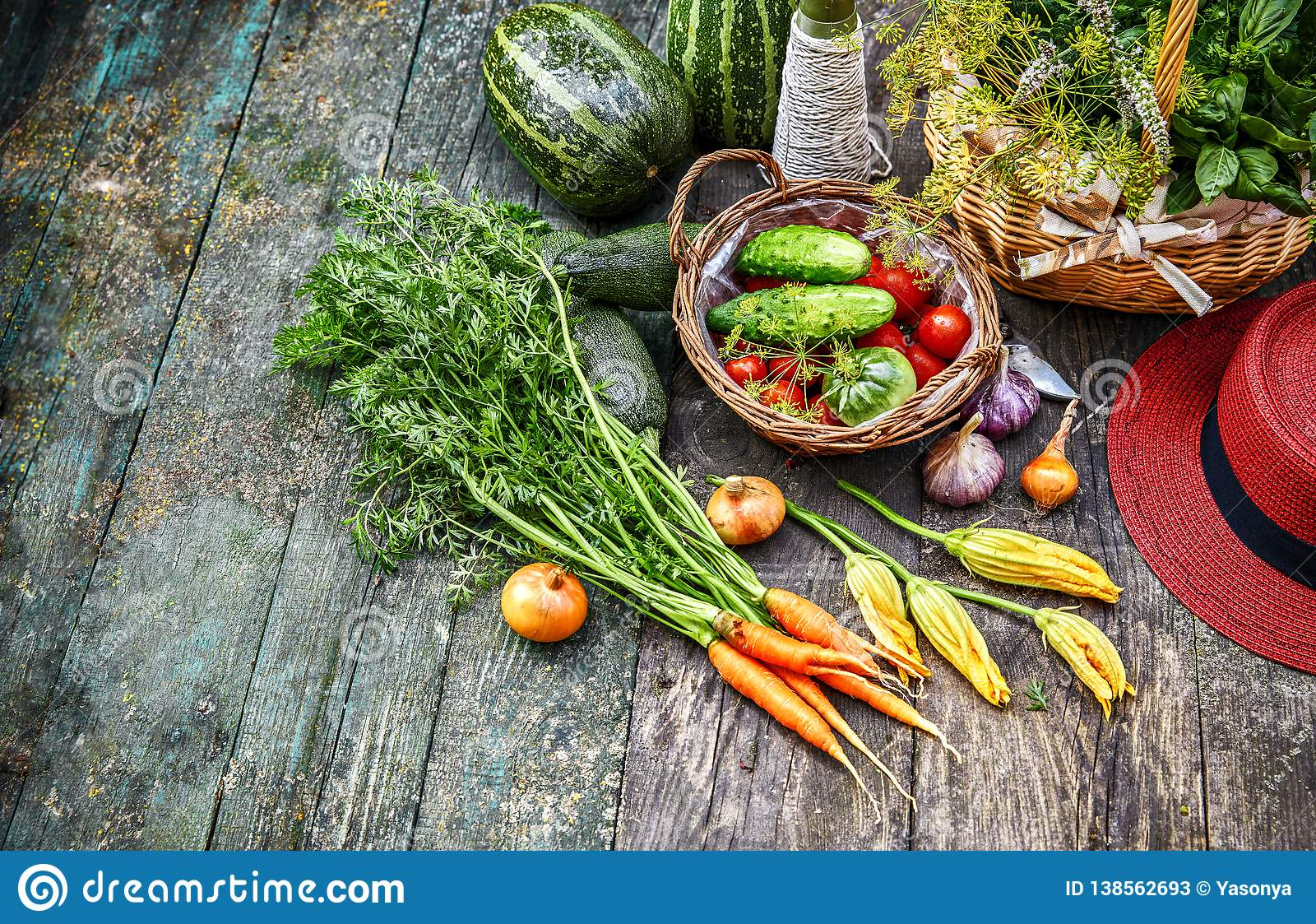 Fresh vegetable and herb at old wooden