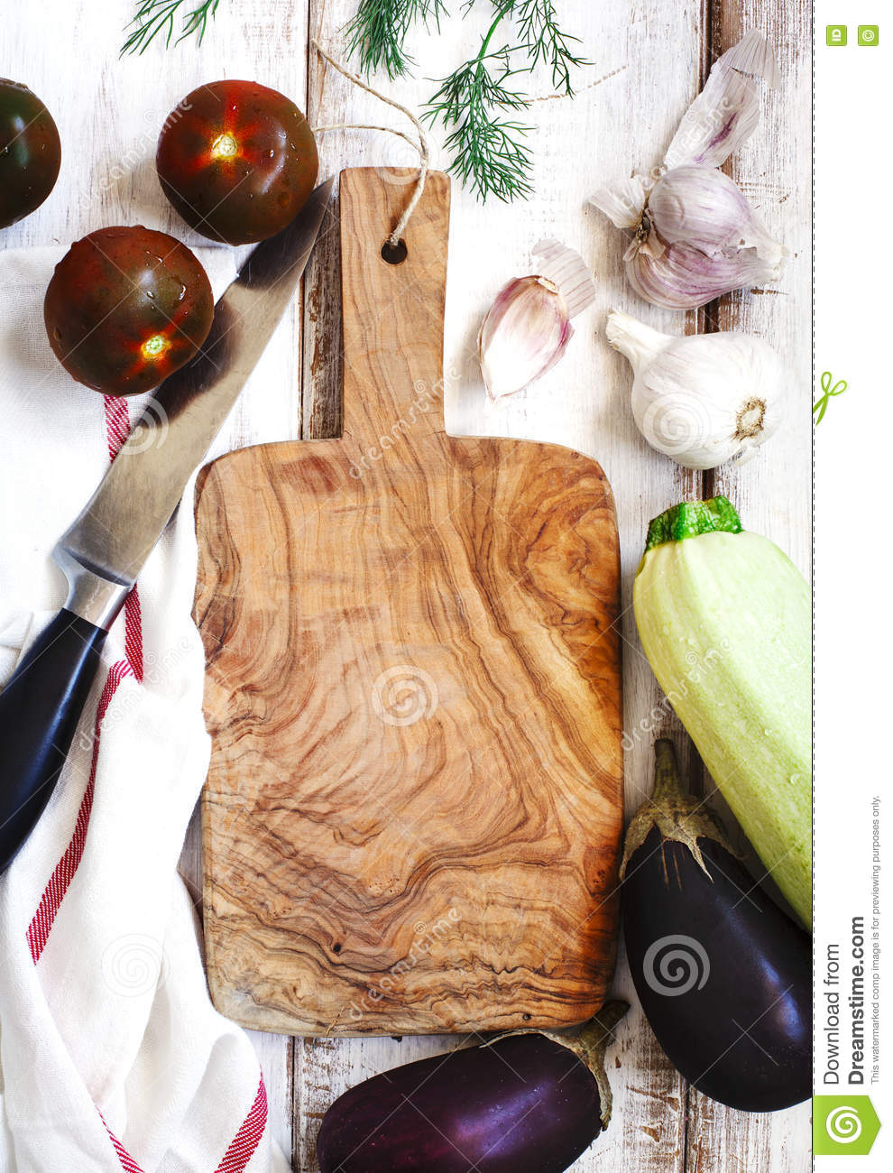 Fresh Vegetables Around Wooden Cutting Board Royalty Free