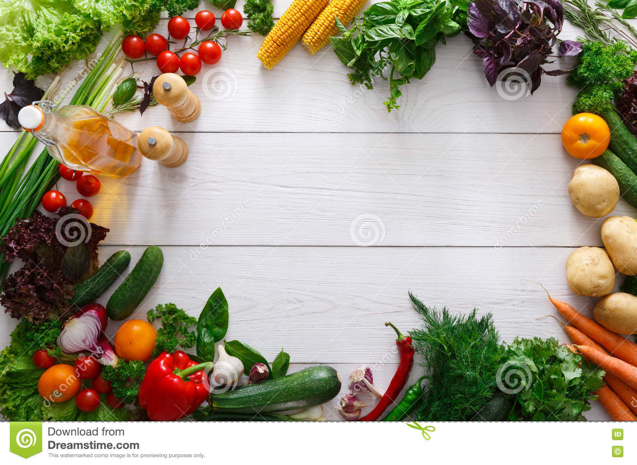 Fresh vegetables frame on white wooden background with