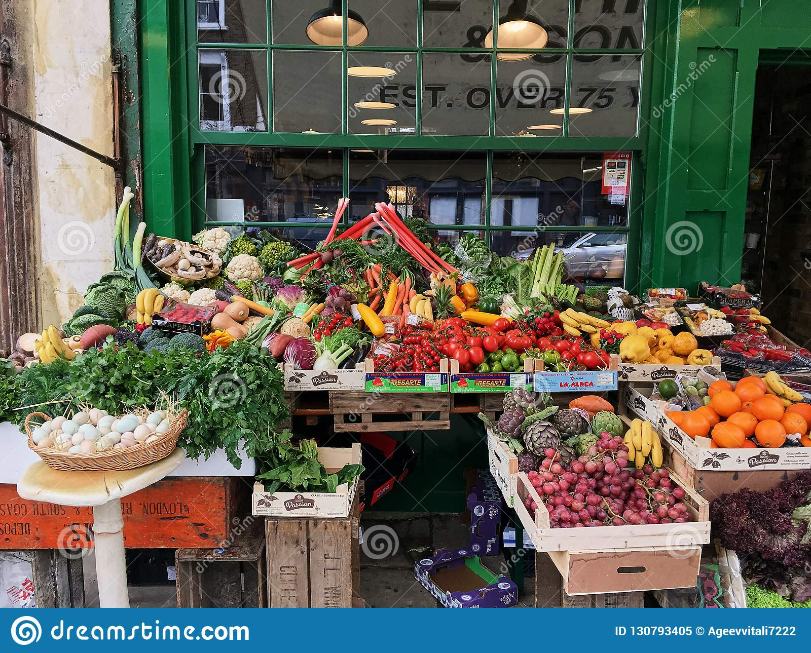 Fresh vegetables on a fruit stand in an outdoor store in London many different vegetables and fruits