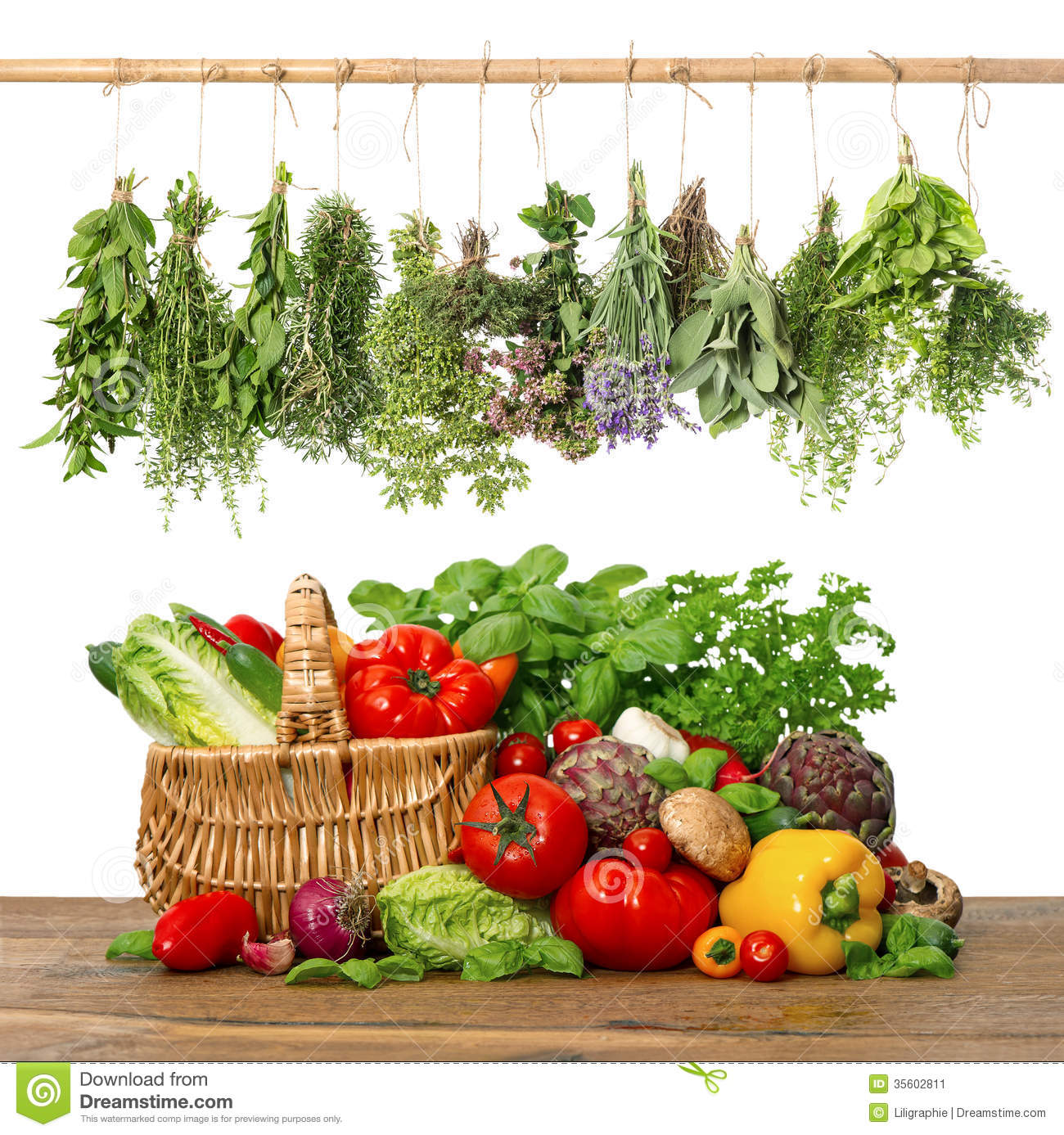 Fresh vegetables and herbs on wooden background. raw food ingredients ...