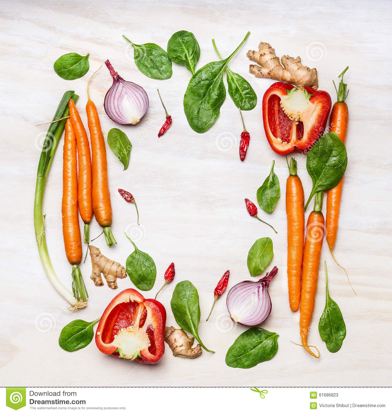 Fresh vegetables ingredients for cooking , composing on white wooden background, top view, frame. Healthy food