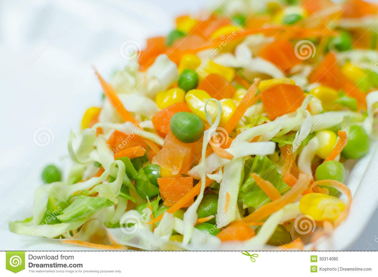 Fresh Vegetables Salad With Cabbage Carrot And Green Peas Royalty Free ...