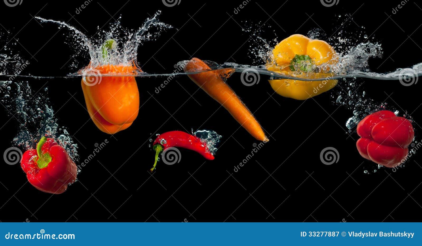 Fresh Vegetables Splashing In Water On Black Stock Image ...
