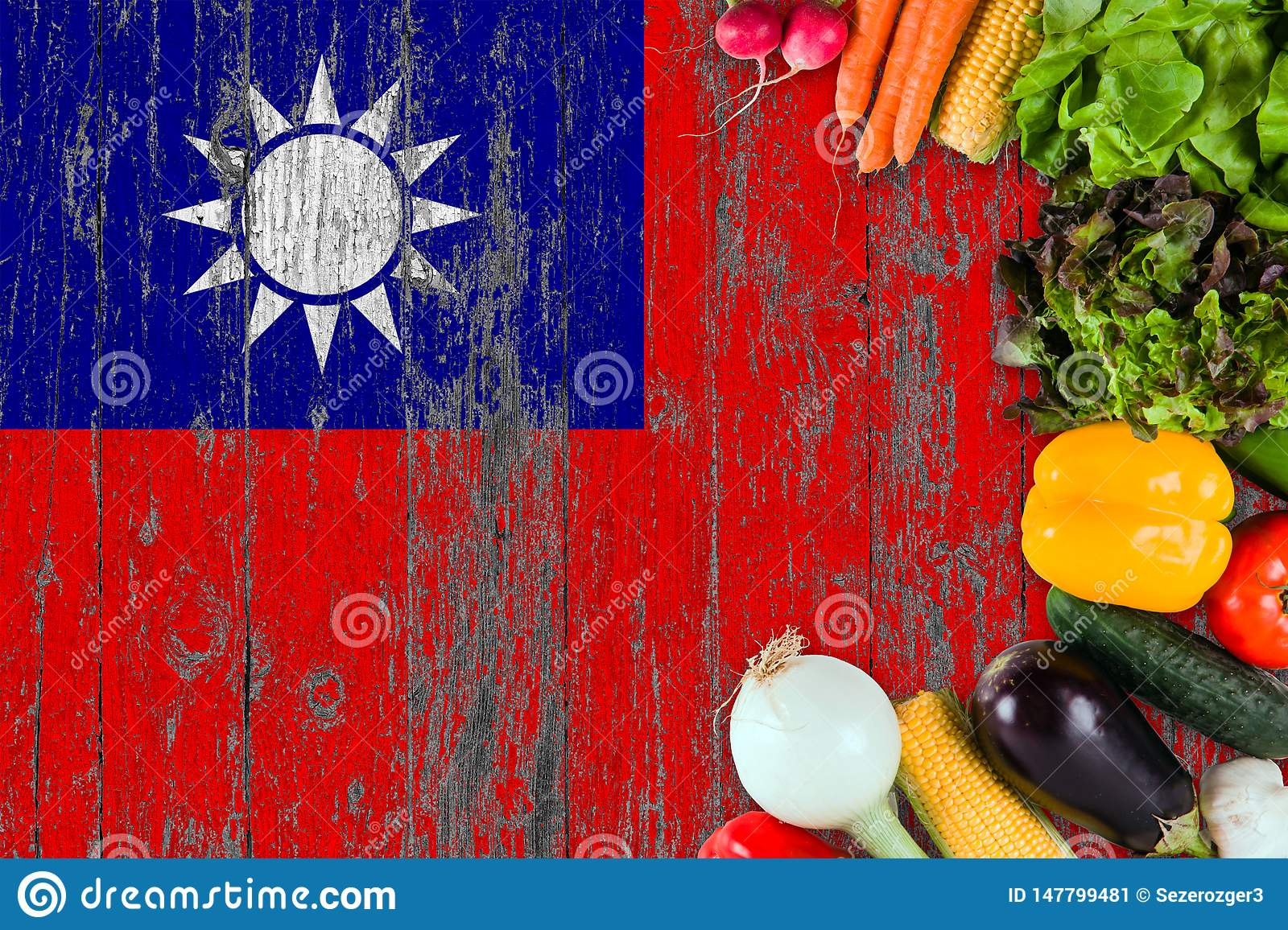 Fresh vegetables from Taiwan on table. Cooking concept on wooden flag background