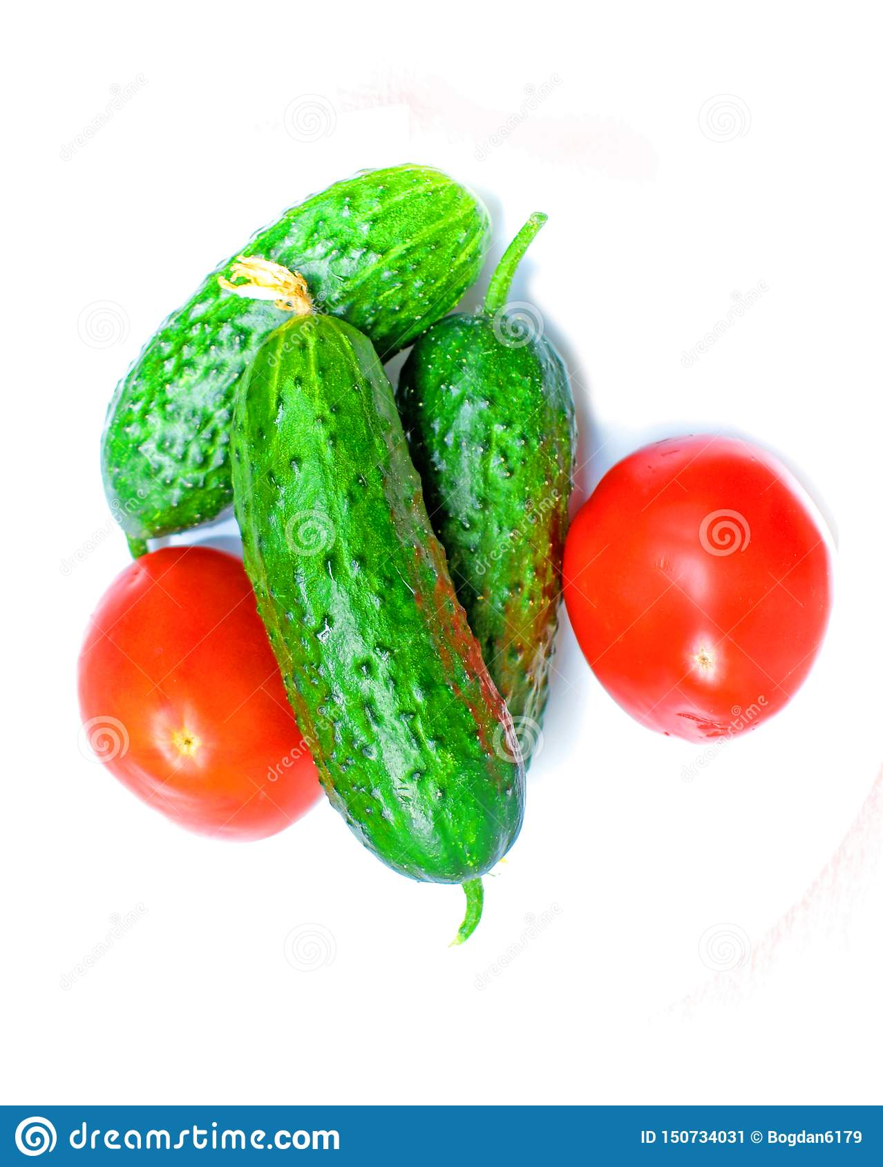 Fresh vegetables. two tomatoes and three cucumbers prepared to make salad