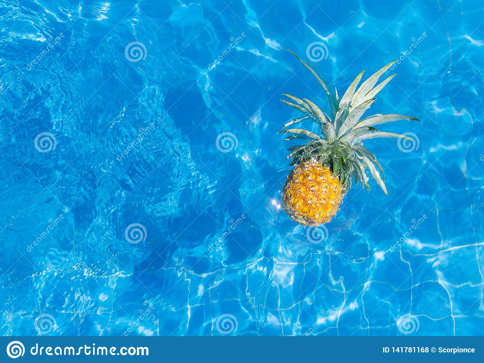 Fresh vibrant pineapple in sunglasses in swimming pool. Healthy lifestyle, travel. Text space