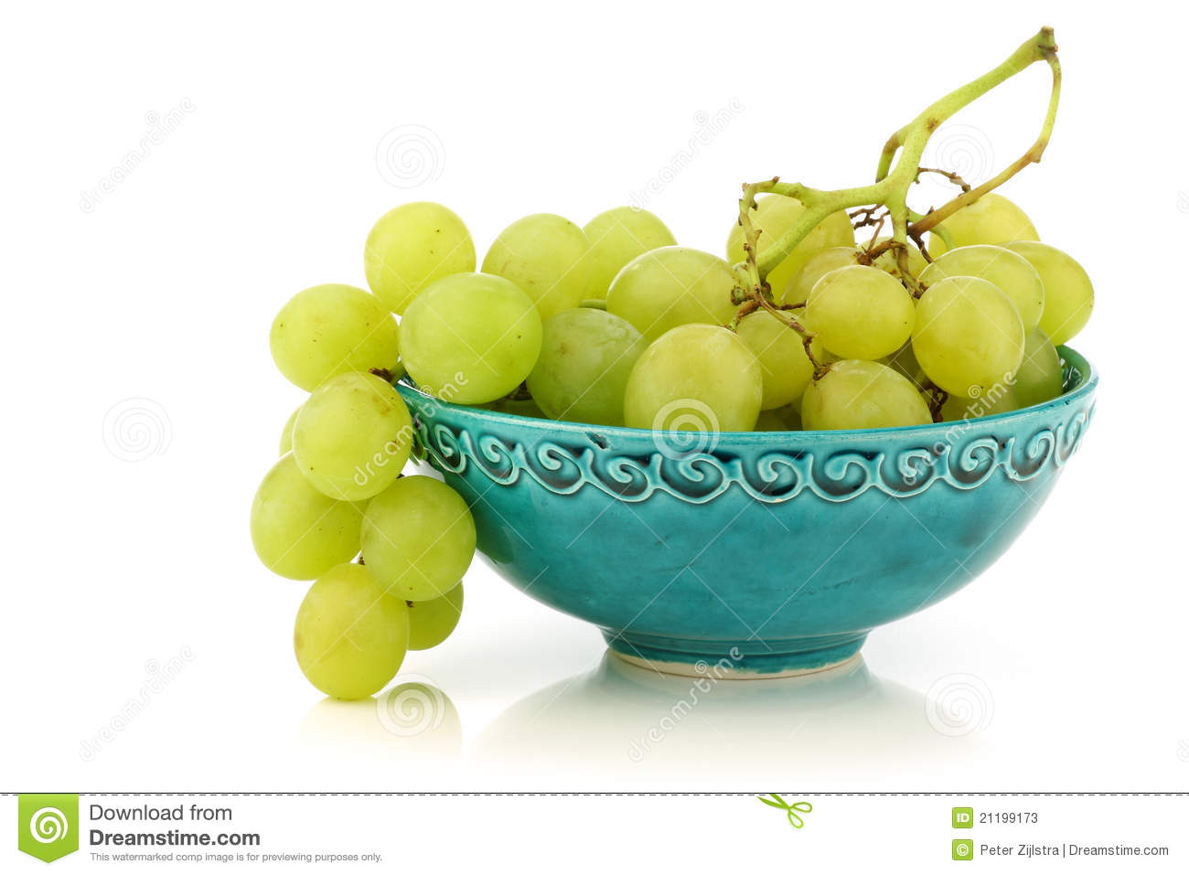 Fresh white grapes in a decorated turquoise bowl