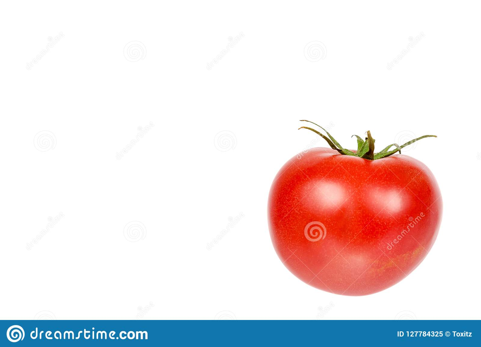 fresh whole raw red tomato with green leaf isolated on white